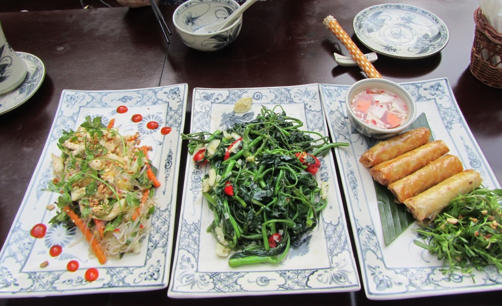 Delicious food. From left to right: Chicken salad with Vietnamese dressing (my new favorite dressing), Morning glory vegetable fried in garlic and deep fried spring rolls.